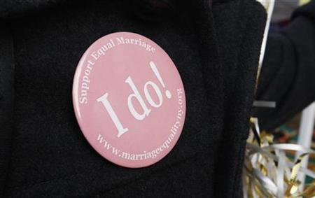 Troy Stover, a supporter of gay marriage wears an ''I Do'' button outside New Haven City Hall in New Haven, Connecticut, November 12, 2008. REUTERS/Mike Segar
