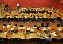 <p>A man is seen at a stock exchange office in a November 13, 2008 file photo. REUTERS/Alexander Natruskin</p>