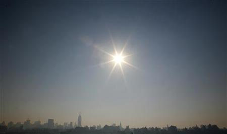 The sun beats down on the haze shrouded skyline of New York across the Hudson River from Hoboken, New Jersey in this August 3, 2006 file photo. This year will be the coolest since 1997 but still the tenth hottest in a temperature record dating back 150 years, the World Meteorological Organization (WMO) said on Tuesday. REUTERS/Gary Hershorn