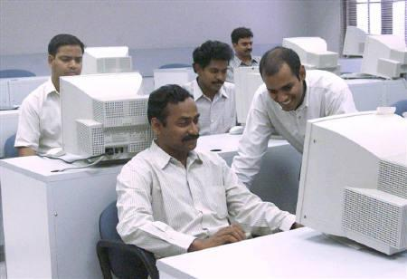 Software engineers work in the laboratory at Satyam Computer Services Ltd in Hyderabad in this March 22 file photo.REUTERS/Savita Kirloskar/Archives