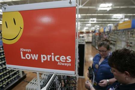 Wal-Mart employees stock the jewelry aisle at a Wal-Mart Supercenter in Rogers, Arkansas in this June 5, 2008 file photo. A leading consumer research firm raised its holiday retail sales outlook on Wednesday, due to what it called Wal-Mart's ''domination'' of the retail industry with its bargain-basement deals. REUTERS/Jessica Rinaldi