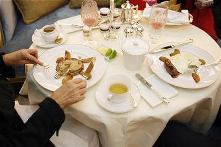 A woman eats breakfast in ''The Plaza'' hotel's ''Palm Court'' the first day that the hotel re-opened following extensive renovations in New York March 1, 2008. REUTERS/Lucas Jackson