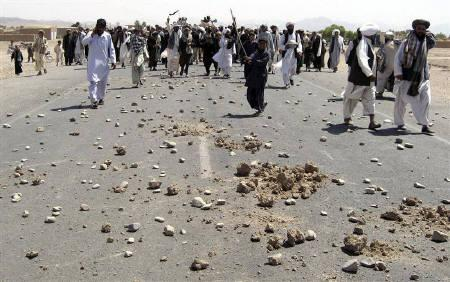 People take part in a protest after an air strike in Azizabad district of Shindand, in Afghanistan in this August 23, 2008 file photo. Civilian deaths in air strikes by foreign forces and violent night raids in Afghanistan are the main cause of Afghan anger against foreign troops, a rights body said on Tuesday. REUTERS/Mohammad Shoiab