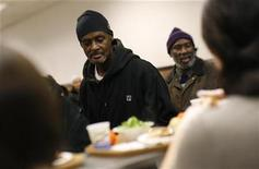 <p>Men line up for plates of food at the Community Kitchen in the Harlem section of New York City December 10, 2008. REUTERS/Mike Segar</p>
