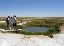 <p>People stand on a platform overlooking an underground spring known as The Bubbler Mound Spring which is fed by the Great Artesian Basin in South Australia, in this handout image made available December 16, 2008. An ancient underground water basin the size of Libya holds the key to Australia avoiding a water crisis, and sustaining $2.4 billion worth of mining, farming and tourism, as climate change bites the drought-hit nation. To match feature ENVIRONMENT-AUSTRALIA/ REUTERS/Great Artesian Basin Coordinating Committee/Handout</p>