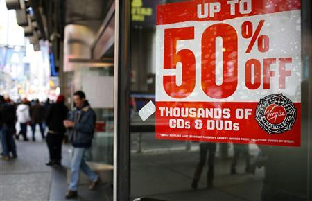 A sale sign hangs on a window at the Virgin Megastore in New York's Times Square, December 26, 2008. U.S. retailers were deeply discounting prices on the day after Christmas to try to bolster slow sales. REUTERS/Mike Segar