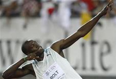 <p>Foto de archivo del velocista Usain Bolt tras ganar la carrera de 100 metros planos en el estadio Letzigrund de Zúrich, 29 ago 2008. El coreógrafo que inventó el baile que realizó el velocista jamaiquino Usain Bolt para celebrar sus victorias en los Juegos Olímpicos de Pekín fue muerto a tiros el viernes en un club nocturno de Kingston, informó la policía. REUTERS/Miro Kuzmanovic</p>