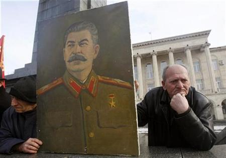 Men hold a portrait of Josef Stalin during a rally marking the anniversary of the Soviet dictator's birth in his home town of Gori, some 80 km (50 miles) west of Tbilisi, December 21, 2008. REUTERS/David Mdzinarishvili