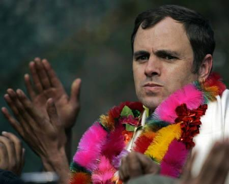 Omar Abdullah, president of the National Conference (NC) party, watches cheering supporters after he won a seat in legislative assembly elections in Srinagar December 29, 2008.  REUTERS/Fayaz Kabli