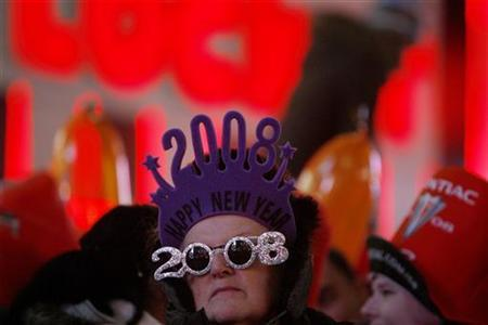 A reveler stands at Times Square just before midnight in New York, December 31, 2007. REUTERS/Lucas Jackson