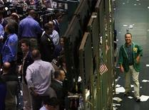 <p>A trader smiles walking outside the energy options pit of the New York Mercantile Exchange October 17, 2008. REUTERS/Shannon Stapleton</p>