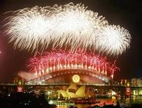 <p>Fireworks explode over the Sydney Harbour Bridge and Opera House during a pyrotechnic show to celebrate the New Year January 1, 2008. REUTERS/Tim Wimborne</p>