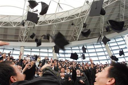 Graduates throw their mortar boards during their graduation ceremony at Fudan University in Shanghai June 28, 2006 REUTERS/Aly Song