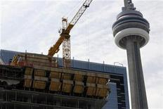 <p>Construction is shown near the CN Tower in Toronto in this May 1, 2008 file photo. Canadian employers cut more jobs in December than expected for a net job loss of 34,400, with the construction sector posting the biggest declines, Statistics Canada said on Friday. REUTERS/ Mike Cassese</p>