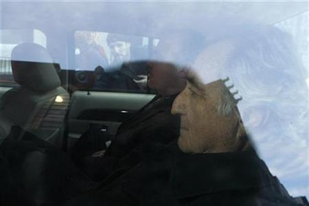 Bernard Madoff (R) is escorted from Federal Court in New York January 5, 2009. REUTERS/Lucas Jackson