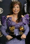 <p>Loretta Lynn backstage with her two awards at the 47th annual Grammy Awards at the Staples Center in Los Angeles February 13, 2005. REUTERS/Mike Blake</p>