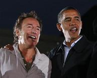 <p>Singer Bruce Springsteen (L) gathers on stage with then Democratic presidential nominee Senator Barack Obama (D-IL) during an election rally in Cleveland, Ohio November 2, 2008. REUTERS/Jason Reed</p>