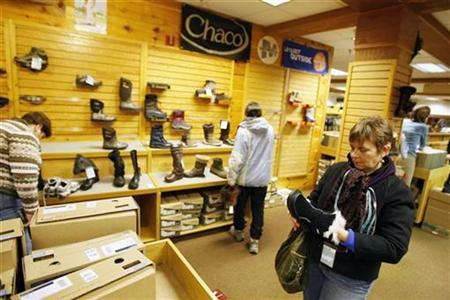 A shopper looks at shoes at a store in Kittery, Maine December 26, 2008. REUTERS/Lucas Jackson