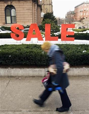 A pedestrian walks past a large ''sale'' sign in the Back Bay shopping district in Boston, Massachusetts January 10, 2009. REUTERS/Brian Snyder