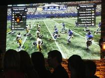 "<p>The video game 'Madden NFL '09"" is projected on a wall in Los Angeles, California August 7, 2008. REUTERS/Fred Prouser</p>"