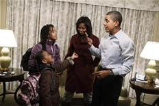 <p>President elect Barack Obama and Michelle Obama get their daughters Sasha (L) and Malia (second from left) ready for their first day of school at Sidwell Friends in Washington January 5, 2009.REUTERS/Callie Shell/Obama Transition Office/Handout</p>