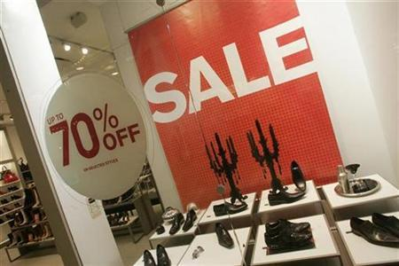 Sale signs are displayed at a shoe store on Christmas Eve at the Beverly Center shopping mall in Los Angeles, California, December 24, 2008. REUTERS/Fred Prouser
