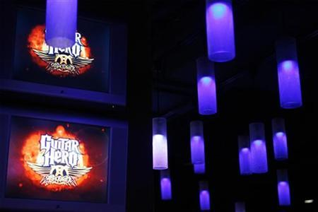 Television screens display the logo for the new video game ''Guitar Hero: Aerosmith'' before a press conference in New York, June 27, 2008. REUTERS/Lucas Jackson