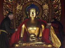 <p>Un tempio buddhista a Pechino, in un'immagine d'archivio. REUTERS/Jason Lee</p>