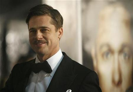 Cast member Brad Pitt attends the premiere of the movie ''The Curious Case of Benjamin Button'' at the Mann's Village theatre in Westwood, California December 8, 2008. The movie opens in the U.S. on December 25. REUTERS/Mario Anzuoni