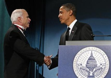 U.S. President-elect Barack Obama shakes hands with U.S. Senator John McCain (R-AZ) at a bipartisan dinner honoring McCain in Washington, DC January 19, 2009. REUTERS/Jim Young