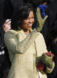 <p>Michelle Obama waves during the inauguration ceremony of her husband, the 44th President of the United States, Barack Obama, in Washington, January 20, 2009. She is holding the Bible her husband was sworn in with, which is also the Bible President Abraham Lincoln used during his inauguration in 1861. REUTERS/Jim Bourg</p>
