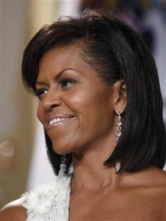 First lady Michelle Obama smiles at her husband, President Barack Obama, at the Presidential Inaugural Youth Ball in Washington January 20, 2009. REUTERS/Jim Young