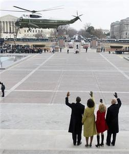 President Barack Obama waves alongside his wife Michelle, and Vice President Joe Biden and his wife Jill, as the presidential helicopter carrying former President George W. Bush and his wife Laura, leave the Capitol after Obama was sworn in as the 44th U.S. President in Washington, January 20, 2009. REUTERS/Saul Loeb/Pool