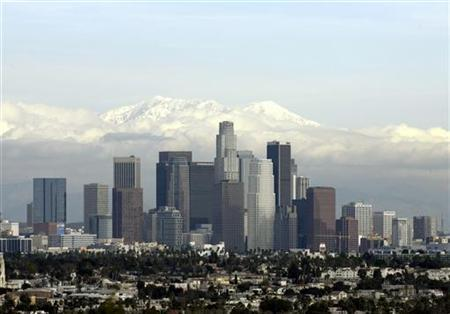 Snow covered San Gabriel Mountains are seen above the downtown Los Angeles skyline January 7, 2008. REUTERS/Danny Moloshok