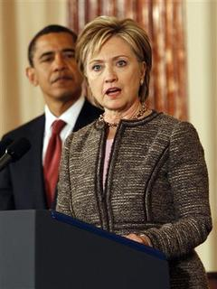 U.S. President Barack Obama listens as Secretary of State Hillary Clinton speaks at the State Department in Washington January 22, 2009. REUTERS/Kevin Lamarque