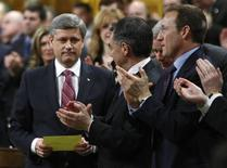 <p>Prime Minister Stephen Harper (L) receives a standing ovation from his caucus in the House of Commons on Parliament Hill in Ottawa January 26, 2009. REUTERS/Chris Wattie</p>