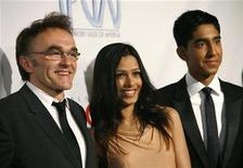 "<p>Indian actress Freida Pinto (C) and British actor Dev Patel (R), cast members of the movie ""Slumdog Millionaire,"" pose with director of the movie Danny Boyle at the 20th annual Producers Guild Awards at The Hollywood Palladium in Los Angeles January 24, 2009. REUTERS/Mario Anzuoni</p>"