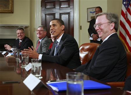 President Barack Obama speaks to the media alongside Google CEO Eric Schmidt (R) and other company CEOs during an economic meeting in the Roosevelt Room of the White House, January 28, 2009. REUTERS/Jason Reed