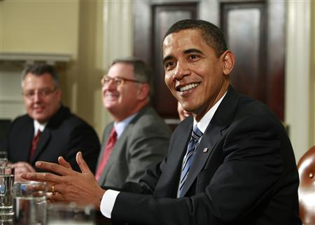President Barack Obama smiles as he talks about his children having a day off school due to the snow, during an economic meeting with company CEOs in the Roosevelt Room of the White House in Washington January 28, 2009. REUTERS/Jason Reed