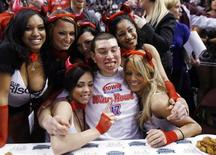 "<p>Wing Bowl champion John ""Super Squibb"" Squibb celebrates after winning the 17th annual chicken wing eating contest in Philadelphia, Pennsylvania, January 30, 2009. REUTERS/Tim Shaffer</p>"