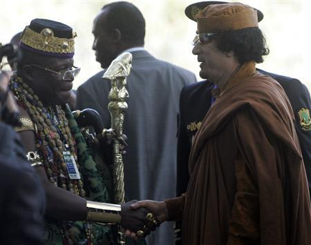 Libyan leader Muammar Gaddafi (R) shakes hands with an unidentified man upon his arrival at the 12th African Union Summit of Heads of States in the United Nations office in Ethiopia's capital Addis Ababa, February 1, 2009. REUTERS/ Antony Njuguna