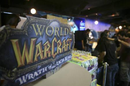 Customers redeem their copies of ''Wrath of the Lich King'' during its launch in Singapore November 14, 2008. ''Wrath of the Lich King'' is the second expansion set for World of Warcraft, a Massively Multiplayer Online Role Playing Game (MMORPG) by Blizzard Entertainment, the games unit of France's Vivendi SA.     REUTERS/Alywin Chew/Files