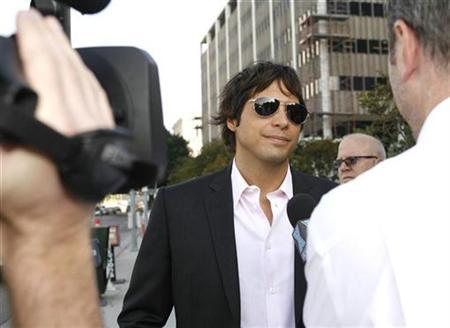 ''Girls Gone Wild'' video series producer Joe Francis arrives at the Edward R. Roybal Federal Building in Los Angeles July 21, 2008. A Los Angeles court on Monday issued an arrest warrant for Francis for failing to appear at a hearing in a tax evasion case. REUTERS/Mario Anzuoni