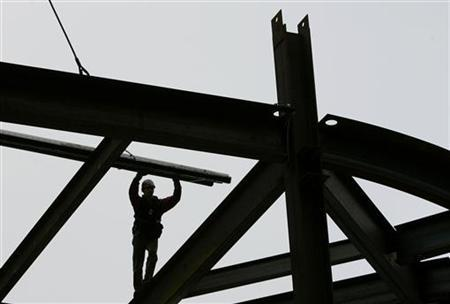 A construction worker balances on a steel beam at 8th Avenue and 42nd Street in New York in this April 21, 2008 file photo. REUTERS/Shannon Stapleton