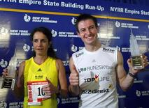 <p>Suzy Walsham, (L) of Australia, and Thomas Dold, of Germany, pose together after each winning the 32nd Annual Empire State Building Run-Up in New York, February 3, 2009. Racers climb up 86 flights to the top of New York's Empire State Building. REUTERS/Brendan McDermid</p>