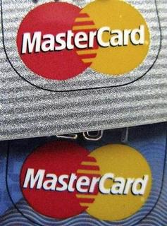 The MasterCard logo is seen on two credit cards April 28, 2008. REUTERS/Sam Mircovich