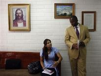 <p>Two mormons talk before attending a mass at the Belgrano Church of Jesus Christ of the Latter-day Saints in Buenos Aires, December 28, 2008. REUTERS/Marcos Brindicci</p>