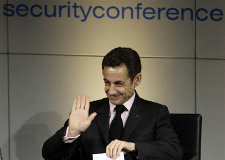 French President Nicolas Sarkozy waves after his arrival at the 45th Conference on Security Policy in Munich February 7, 2009. There is no alternative to tightening sanctions against Iran over its nuclear work if it does not meet western demands and Russia must show it is ready help with such a move, Sarkozy said. REUTERS/Michaela Rehle