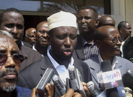 Sheikh Sharif Ahmed (C), former leader of the opposition Alliance for Re-Liberation of Somalia (ARS) and the new President of Somalia, speaks to the media upon his arrival in Mogadishu February 7, 2009. REUTERS/Mowliid Abdi