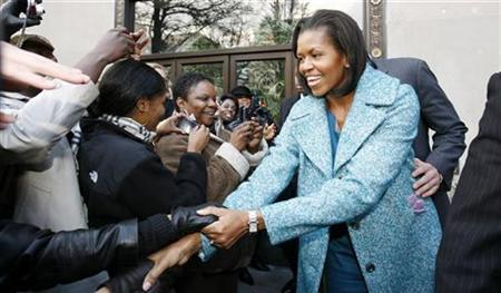 First lady Michelle Obama shakes hands with well-wishers as she departs Georgia Brown's restaurant in Washington January 30, 2009. REUTERS/Kevin Lamarque